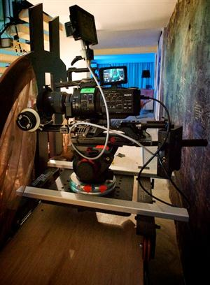 Dolly rigged for shots behind the bed